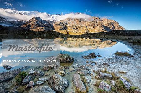 Sunrise reflections at Lake Rosole, Forni Valley, Valfurva, Valtellina, Lombardy, Italy, Europe