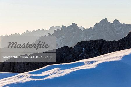 Dawn lights frames Cadini of Misurina. Dolomites. Auronzo of Cadore. Veneto. Italy. Europe