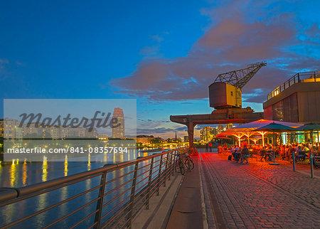 Restaurant beneath old dockyard crane by River Main, Frankfurt-am-Main, Hesse, Germany, Europe