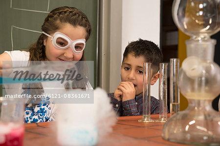 School students mixing liquid in chemistry class, Fürstenfeldbruck, Bavaria, Germany