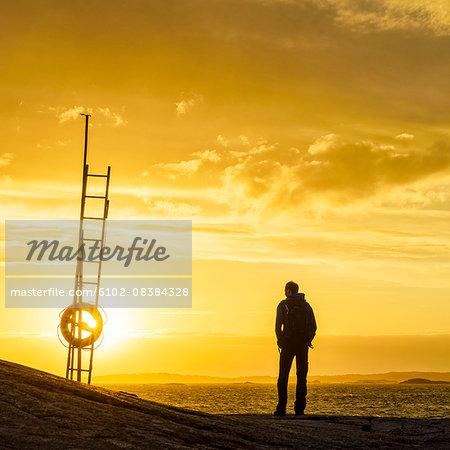 Man watching sunset at sea