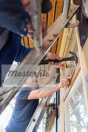 Men repairing window
