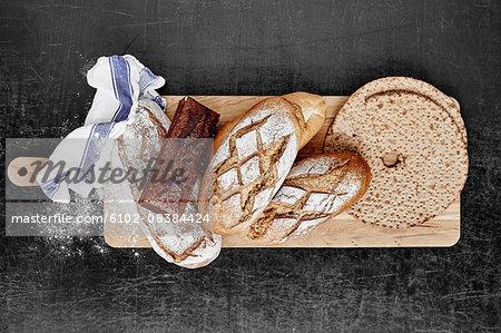 Bread on wooden chopping board