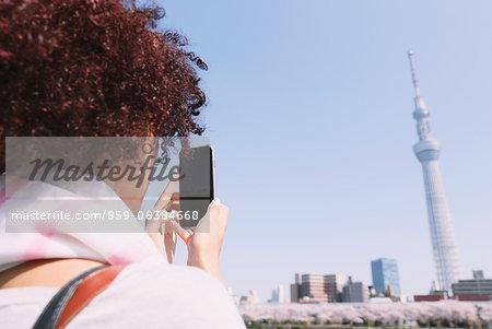Young woman enjoying tourism in Tokyo