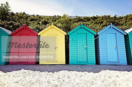 brightly coloured beach huts