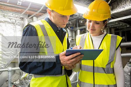 Engineers working in temperature control room