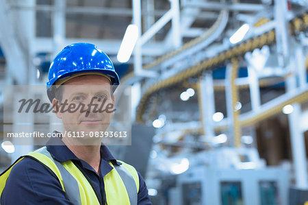 Portrait confident worker in hard-hat