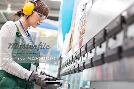 Female worker working in factory