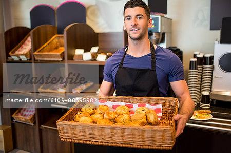 Handsome waiter smiling at camera