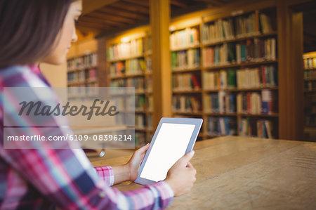 Female student using digital tablet