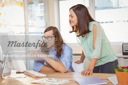 Creative businessman explaining colleague in office