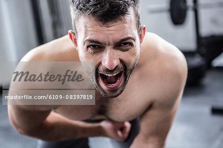 Fit man shouting at camera