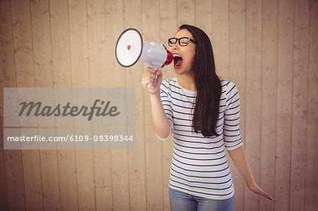 Beautiful woman shouting with megaphone