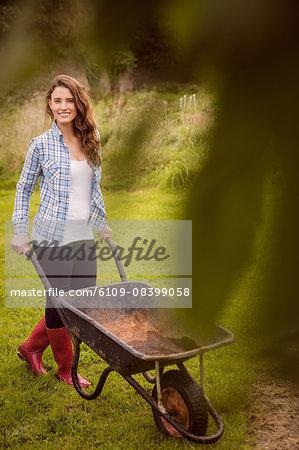 Woman posing with a wheelbarrow