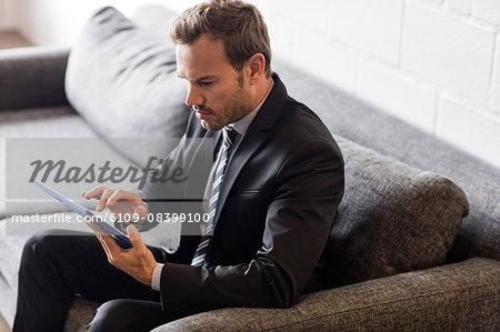 Focused businessman using tablet