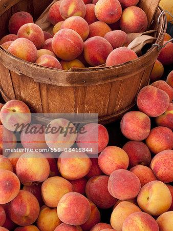Fresh white peaches on a market stall