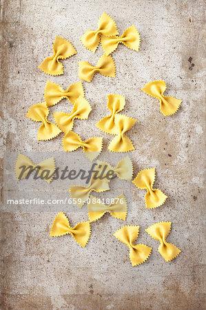 Turmeric farfalle on metal surface
