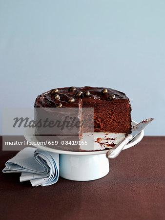 A chocolate Angel Cake on a cake stand, sliced