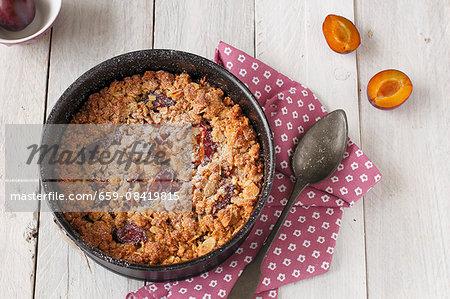 Plum crumble in baking dish
