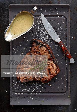 Grilled T-bone steak with gravy