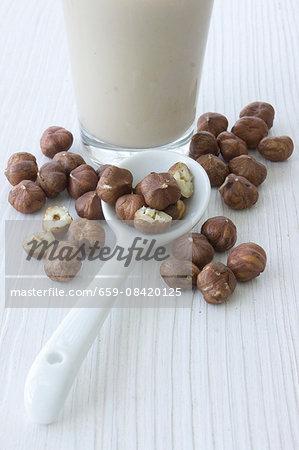 Hazelnut milk and hazelnuts on a spoon