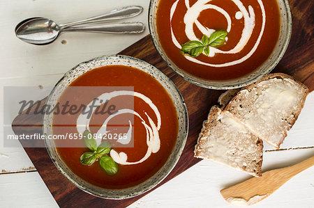 Tomato soup with cherry, crème fraîche and basil