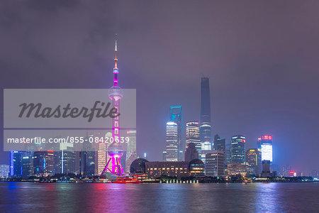 Skyscrapers on Lujiazui at night, Pudong skyline view from Bund (Waitang) over Huangpu river (Huangpujiang), Shanghai, PRC.