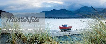 Fishing boat with Barmouth Bridge in background, coast of Cardigan Bay, Gwynedd, Wales, United Kingdom, Europe