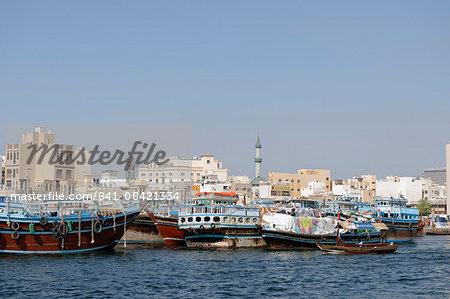 Trading dhows on the docks of Dubai Creek, Deira, Dubai, United Arab Emirates, Middle East
