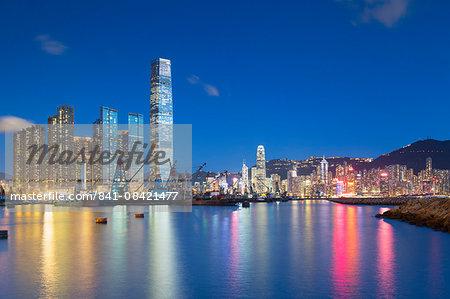 International Commerce Centre (ICC) and Yau Ma Tei Typhoon Shelter at dusk, West Kowloon, Hong Kong, China, Asia