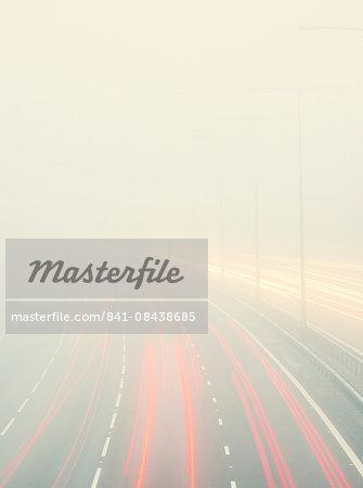 Motorway traffic in thick fog, United Kingdom, Europe