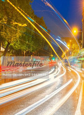 Streams of car headlights at night, London, England, United Kingdom, Europe