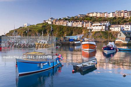 Cornish fishing boats in Mevagissey harbour at sunrise, Cornwall, England, United Kingdom, Europe