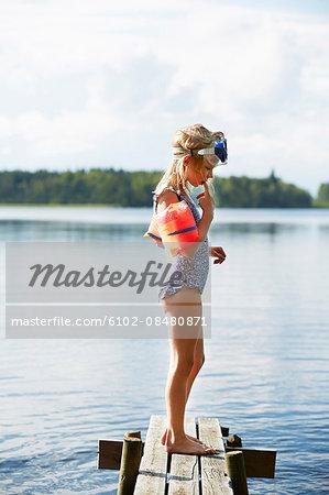 Girl standing on jetty