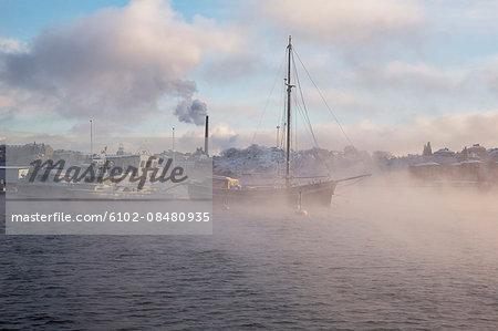 Boats on sea in fog