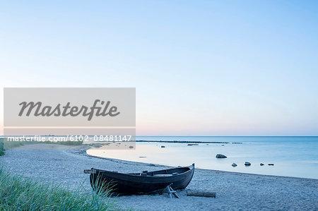 Boat on beach at dusk