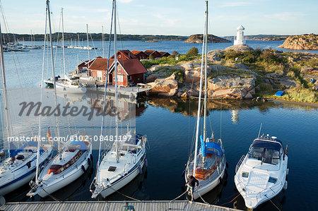 Sailing boats moored at coast