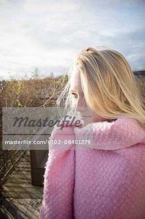 Girl wrapped in blanket looking away