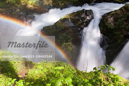 Rainbow over waterfall, Olympic National Park, Washington, USA