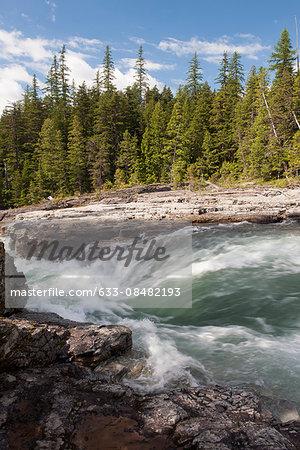 Stream rushing over rocks in Glacier National Park, Montana, USA