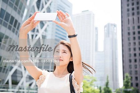 Business woman taking self portrait