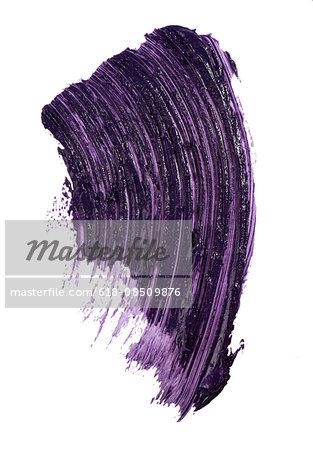 A cut out beauty product shot of purple mascara