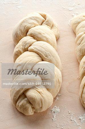 Unbaked bread plaits
