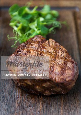 Grilled beef steak on a wooden board