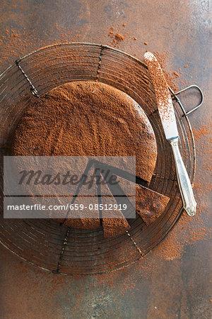 Whiskey truffle cake with cocoa powder, sliced