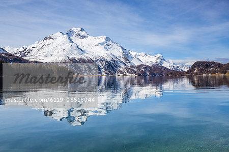 Piz da la Margna is reflected in the clear water of Lake Sils, Maloja Pass, Engadine, Canton of Graubunden, Switzerland, Europe