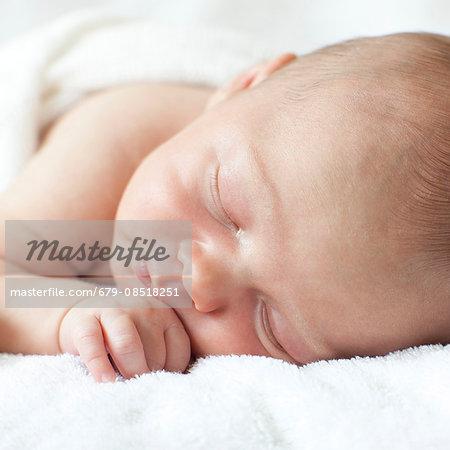 Newborn baby boy asleep.