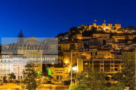 Illuminated city and Castelo de Sao Jorge at dawn, blue hour, Alfama District, Lisbon, Portugal