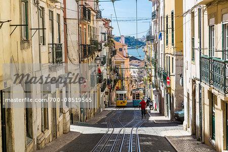 Elevador da Bica cable cars on a steep street in the Chiado District, Lisbon, Portugal