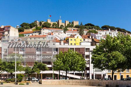 Largo Martim Moniz and Castelo de Sao Jorge on the hilltop in the background, Alfama District, Lisbon, Portugal